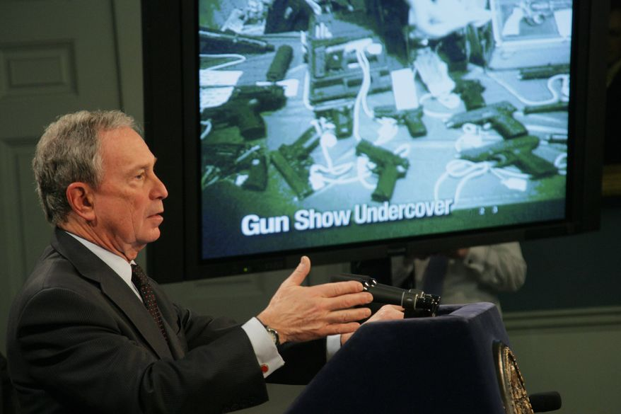 New York Mayor Michael Bloomberg shows an undercover video at City Hall in New York on Monday, Jan. 31, 2011, in which, Mr. Bloomberg said, undercover investigators working for the city were not required to pass a background check at a Phoenix gun show when they bought a pistol with an extended magazine. (AP Photo/New York City Mayor's Office, Edward Reed)