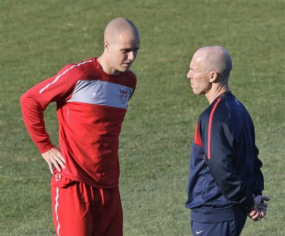 """FILE - In this file photo of Friday, June 18, 2010 United States' Michael Bradley, right, competes for the ball with Slovenia's Milivoje Novakovic, left, during the World Cup group C soccer match between Slovenia and the United States at Ellis Park Stadium in Johannesburg, South Africa. American midfielder Michael Bradley is taking a physical and close to joining Premier League club Aston Villa on loan. Aston Villa boss Gerard Houllier said Monday Jan. 31, 2011 that U.S. international Michael Bradley was having a medical, with a view to joining on loan.""""  The 23-year-old son of U.S. coach Bob Bradley is set to join the central England club until the end of the season from Germany's Borussia Moenchengladbach. (AP Photo/Luca Bruno)"""