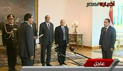Egyptian President Hosni Mubarak, right, swears in Cabinet Minister for Communications and Information Technologies Tariq Mohamed Kmel Mamoud, front left, during a ceremony Monday Jan. 31, 2011. ( AP Photo / Egypt State TV)