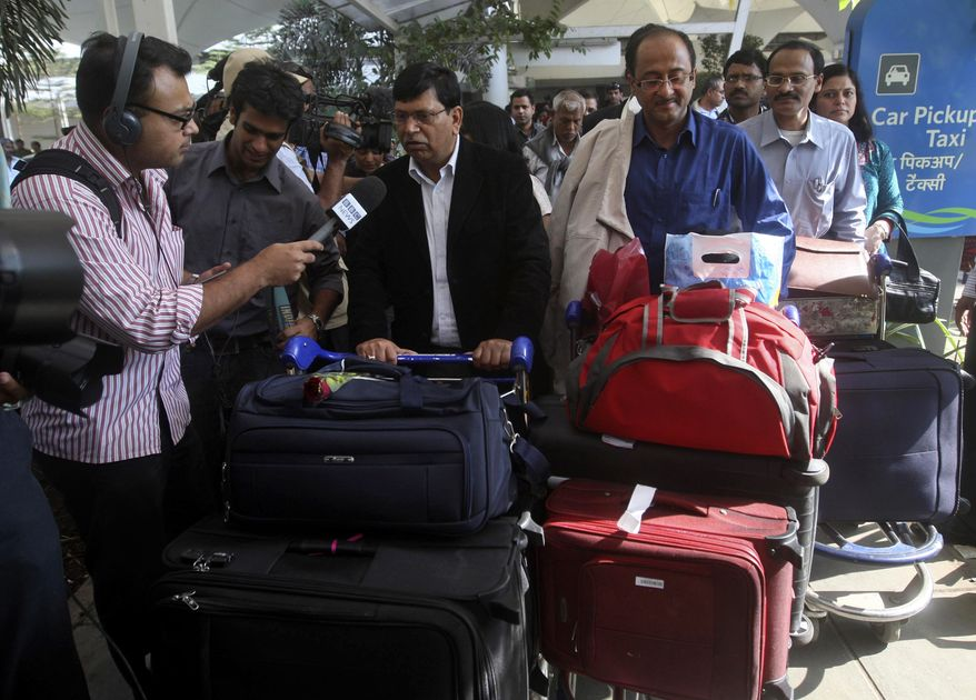 An Indian national is interviewed by a reporter as he arrives in Mumbai, India, on Monday, Jan. 31, 2011, on a special Air India evacuation flight carrying more than 300 passengers from Egypt's capital, Cairo. (AP Photo/Rafiq Maqbool)