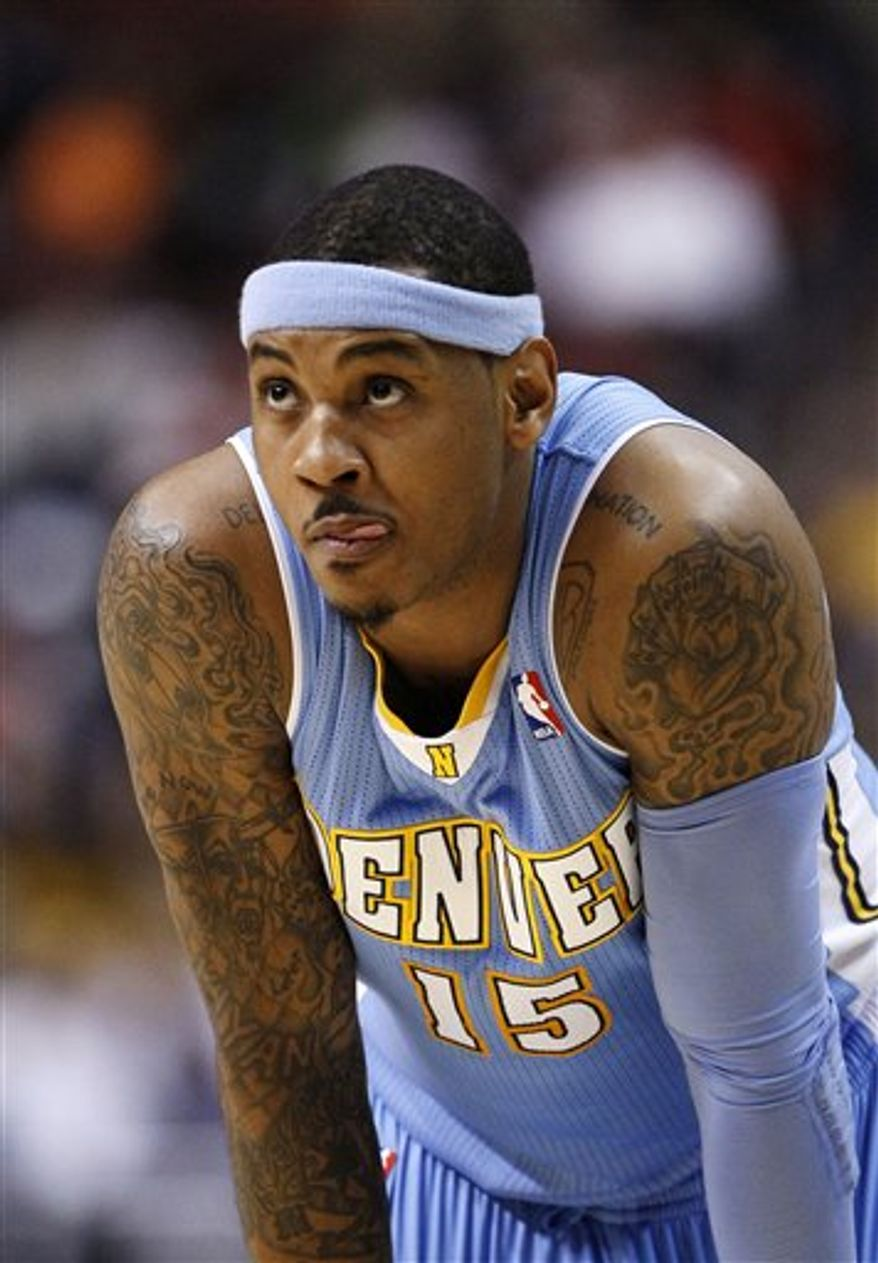 Denver Nuggets' Carmelo Anthony watches a free throw attempt in the first half of an NBA basketball game against the Philadelphia 76ers, Sunday, Jan. 30, 2011, in Philadelphia. Philadelphia won 110-99. (AP Photo/Matt Slocum)