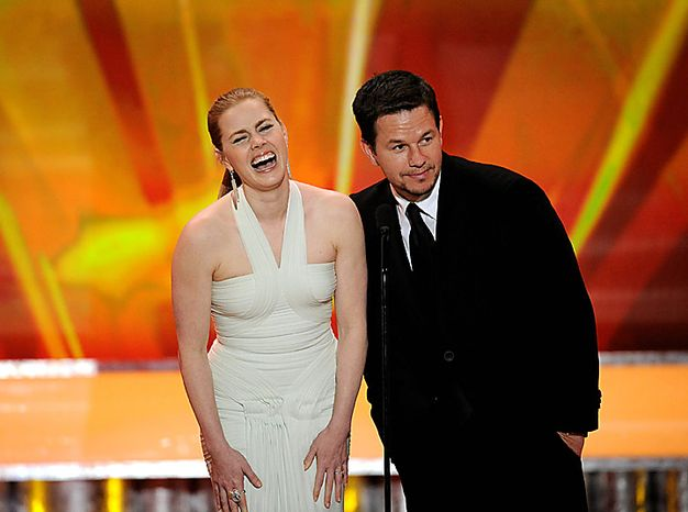 Amy Adams, left, and Mark Wahlberg share the stage at the 17th Annual Screen Actors Guild Awards on Sunday, Jan. 30, 2011, in Los Angeles. (AP Photo/Mark J. Terrill)