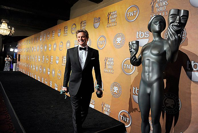 "Colin Firth holds awards for best actor and ensemble for "" The King's Speech"" at the 17th Annual Screen Actors Guild Awards on Sunday, Jan. 30, 2011, in Los Angeles. (AP Photo/Chris Pizzello)"