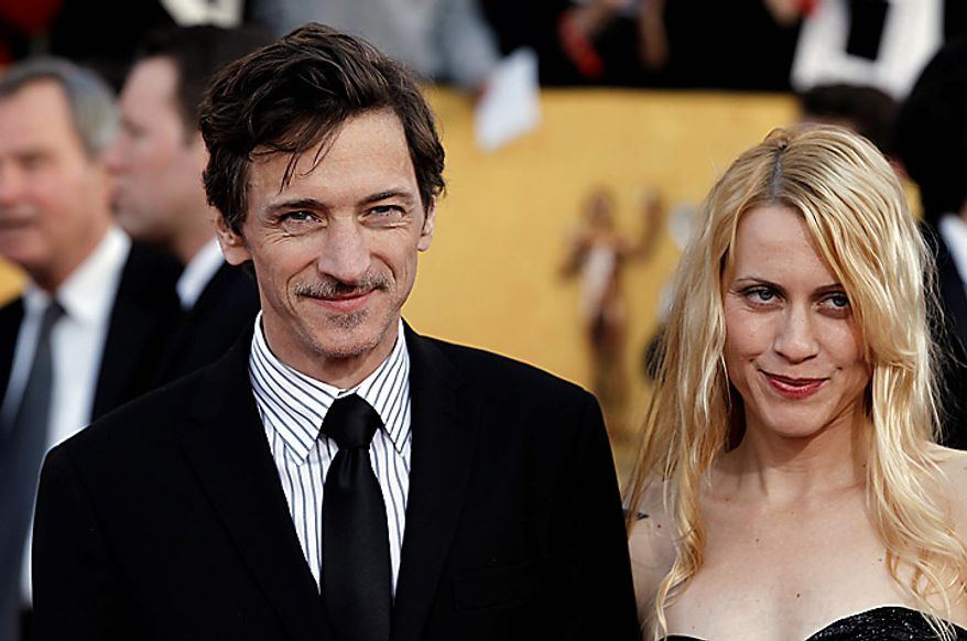 John Hawkes, left, and a guest arrive at the 17th Annual Screen Actors Guild Awards on Sunday, Jan. 30, 2011, in Los Angeles. (AP Photo/Matt Sayles)
