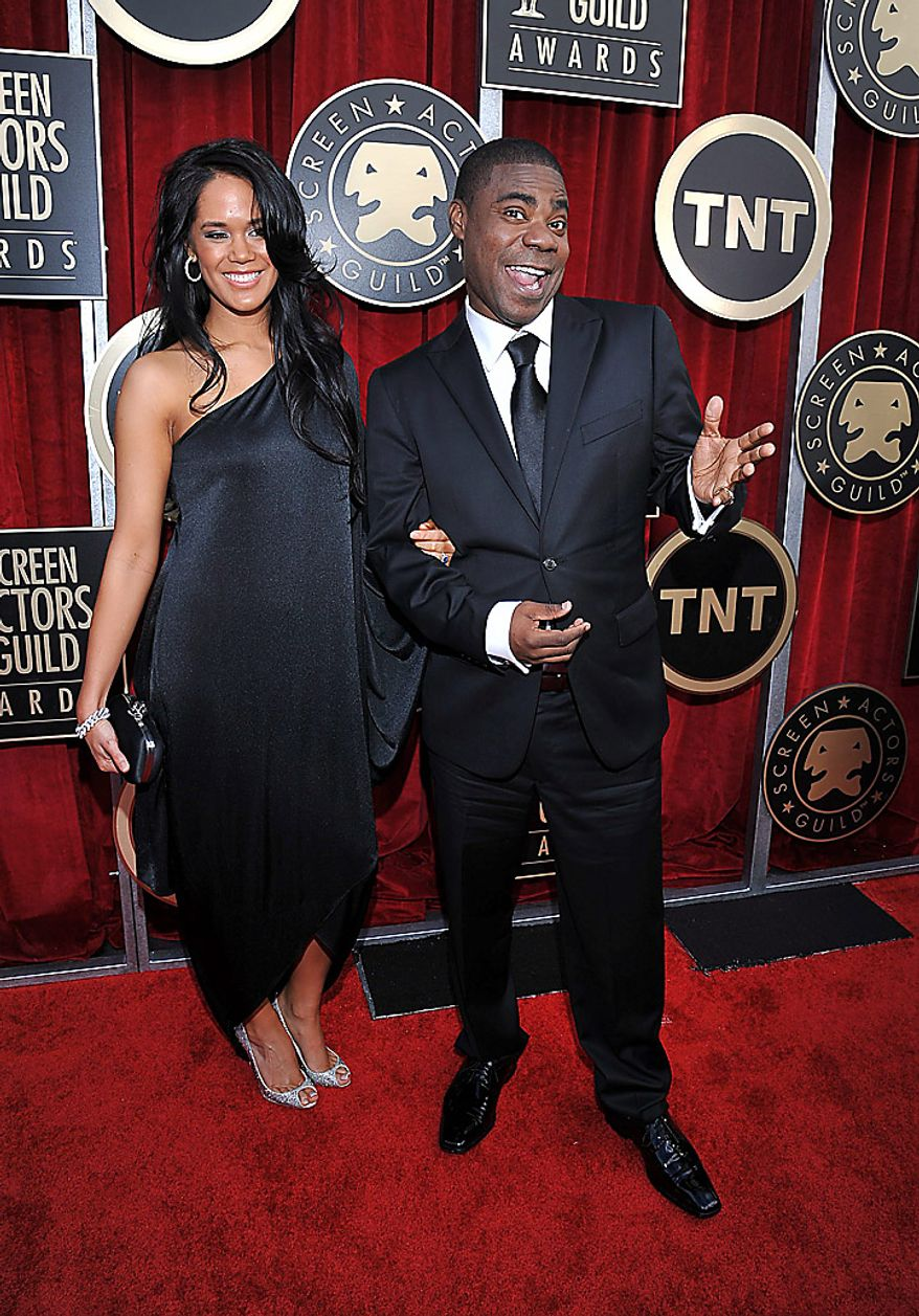 Tracy Morgan, right, and a guest arrive at the 17th Annual Screen Actors Guild Awards on Sunday, Jan. 30, 2011, in Los Angeles. (AP Photo/Matt Sayles)