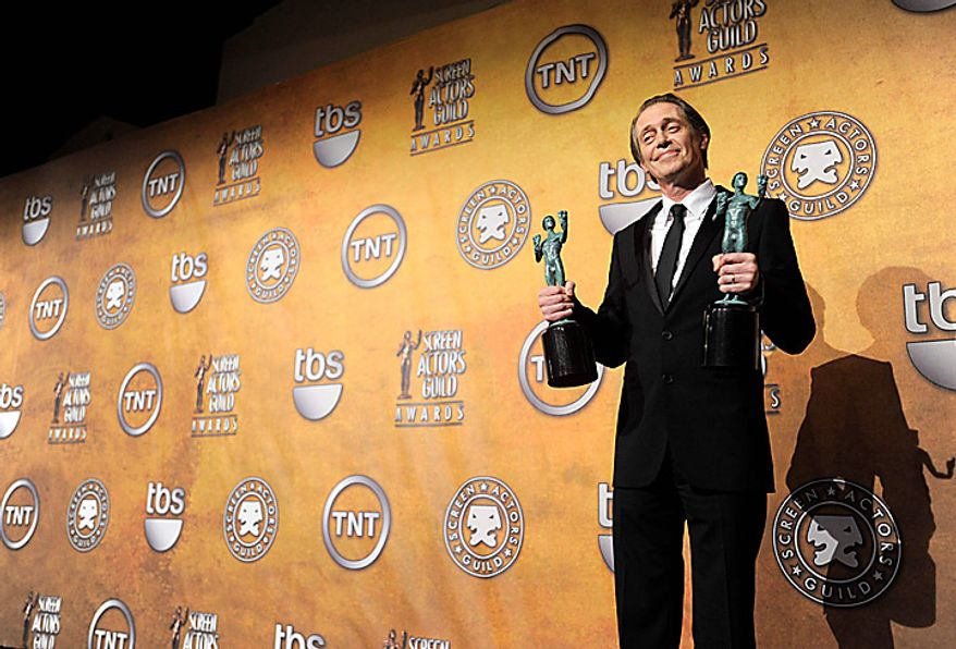 """Steve Buscemi poses with the best male actor in a drama series and best ensemble in a drama series trophies for his work on """"Boardwalk Empire"""" at the 17th Annual Screen Actors Guild Awards on Sunday, Jan. 30, 2011, in Los Angeles. (AP Photo/Vince Bucci)"""