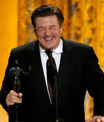 "Alec Baldwin accepts the award for best male actor in a comedy series for ""30 Rock"" at the 17th Annual Screen Actors Guild Awards on Sunday, Jan. 30, 2011, in Los Angeles. (AP Photo/Mark J. Terrill)"