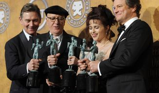 "From left, Anthony Andrews, Geoffrey Rush, Helena Bonham Carter and Colin Firth hold best ensemble awards for "" The King's Speech"" at the 17th Annual Screen Actors Guild Awards on Sunday, Jan. 30, 2011, in Los Angeles. Mr. Firth also won best actor. (AP Photo/Chris Pizzello)"