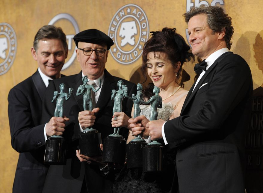 """From left, Anthony Andrews, Geoffrey Rush, Helena Bonham Carter and Colin Firth hold best ensemble awards for """" The King's Speech"""" at the 17th Annual Screen Actors Guild Awards on Sunday, Jan. 30, 2011, in Los Angeles. Mr. Firth also won best actor. (AP Photo/Chris Pizzello)"""