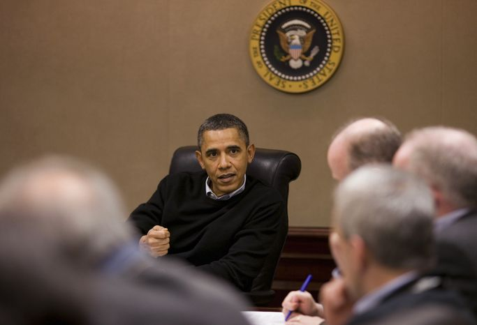 In this photo released by the White House, President Obama is briefed on the events in Egypt by his national security team in the Situation Room of the White House on Saturday. Thousands of protesters in Egypt have thrown the country's 30-year-old regime into tumult. (Associated Press)