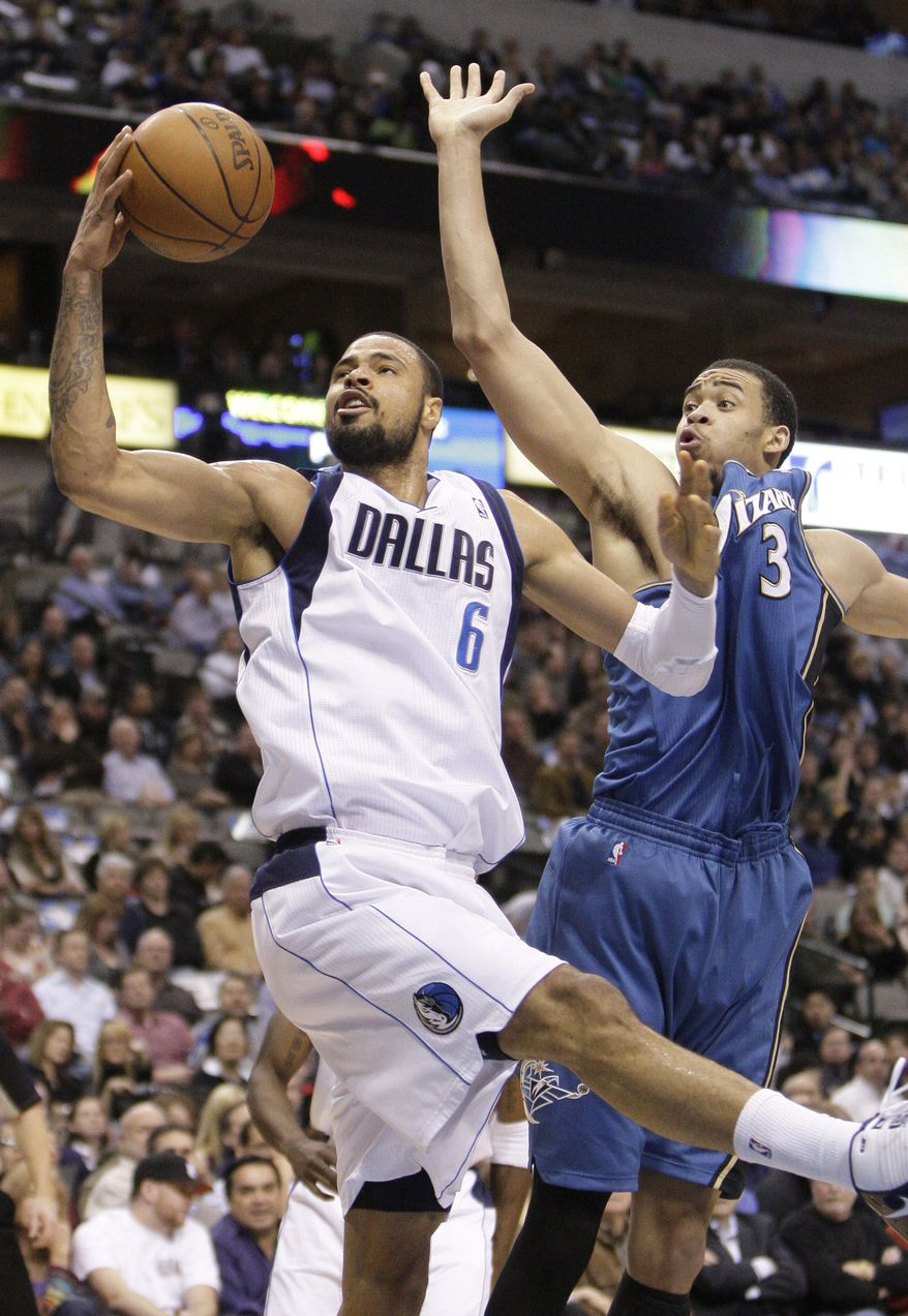 Dallas Mavericks center Tyson Chandler (6) reaches out for a rebound against Washington Wizards center JaVale McGee, right, during the first half of an NBA basketball game in Dallas on Monday, Jan. 31, 2011. (AP Photo/Mike Fuentes)