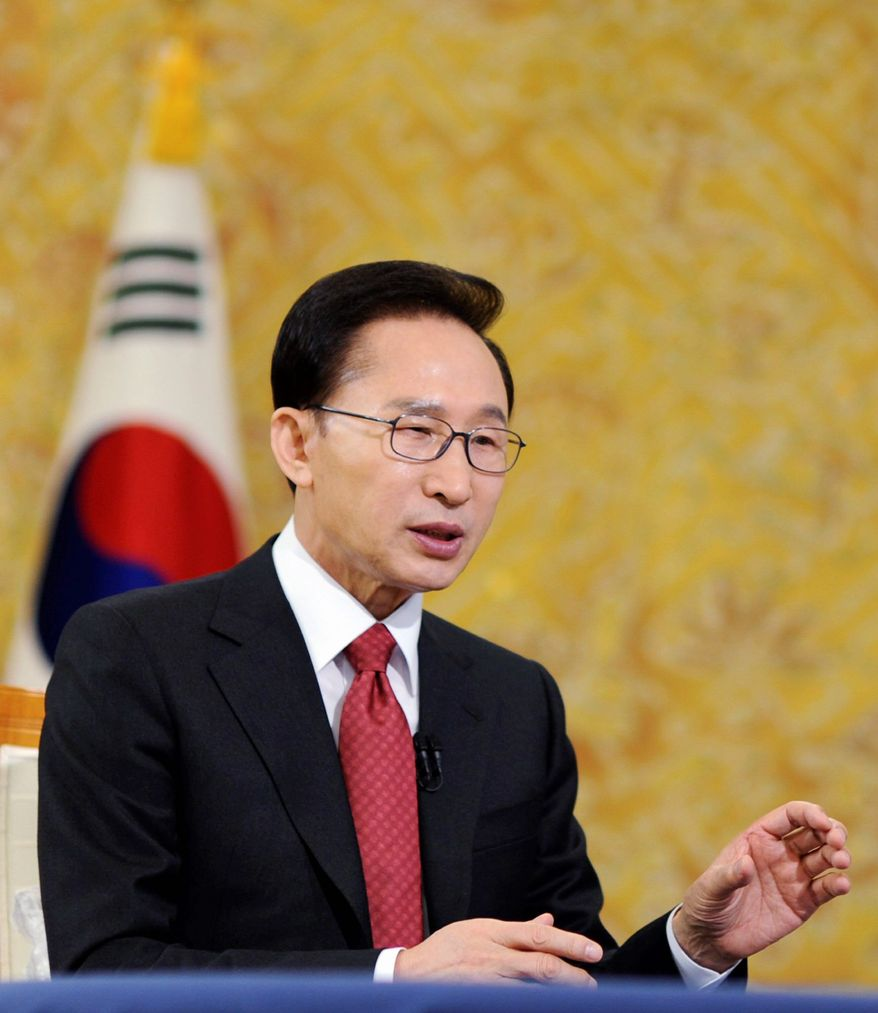At the presidential Blue House in Seoul on Tuesday, South Korean President Lee Myung-bak urges North Korea to show responsibility for two deadly attacks last year. (Associated Press)