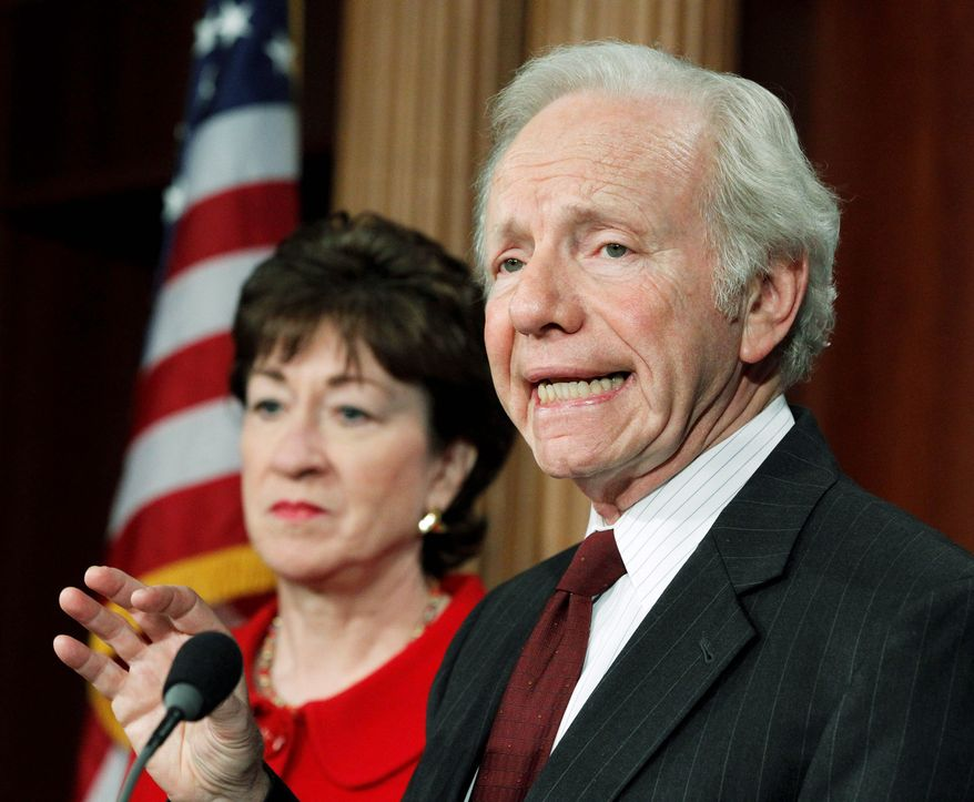 Senate Homeland Security and Governmental Affairs Committee Chairman Sen. Joe Lieberman, Connecticut independent, speaks Tuesday at a news conference on the release of a report on northern border security. The panel's ranking member, Sen. Susan Collins, Maine Republican, looks on. (Associated Press)