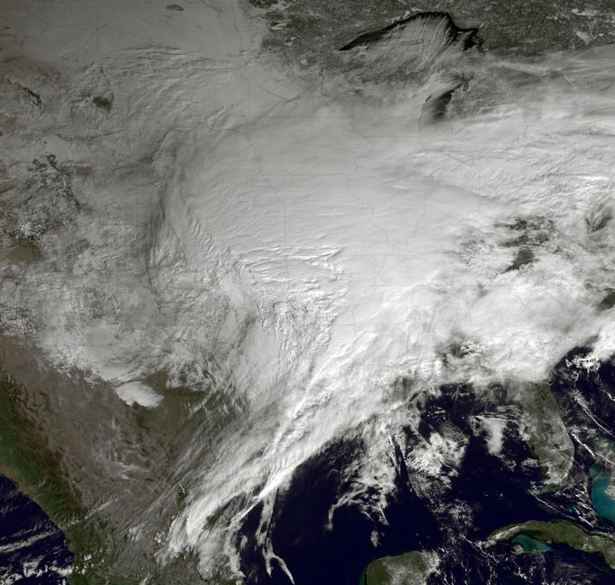 This satellite image from NOAA shows the breadth of the weather system. In the aftermath of the snow and ice, the storm will leave temperatures in the single digits or lower. (Associated Press)