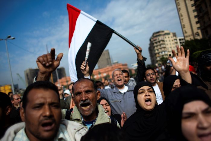 Anti-government protesters shout their demands Tuesday as they march toward Tahrir Square in Cairo. Egyptian authorities have sought to save President Hosni Mubarak's regime with a series of concessions and promises to protesters, but the democratic fervor in the streets may prevail. Mr. Mubarak has announced he will not run for re-election in September. (Associated Press)