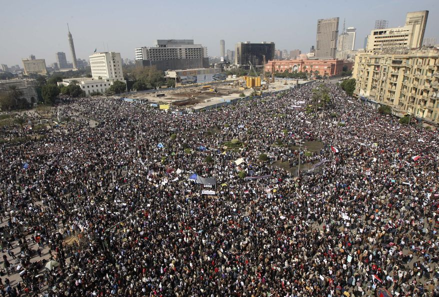 More than a quarter-million people gather in Tahrir, or Liberation, Square in central Cairo on Tuesday, Feb. 1, 2011, to demand that President Hosni Mubarak leave office after nearly 30 years in power. (AP Photo/Khalil Hamra)