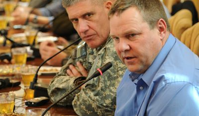 ** FILE ** In this photo provided by the International Security Assistance Force (ISAF), Sen. Jon Tester (right), Montana Democrat, and Army Lt. Gen. David M. Rodriguez, commander of the ISAF Joint Command and deputy commander of U.S. forces in Afghanistan, speak with the governor of Kandahar province, Tooryalai Wesa, concerning the current status of his province during a briefing at the governor's palace on Friday, Jan. 21, 2011, in Kandahar, Afghanistan. (AP Photo/U.S. Navy, Chief Jason Carter)