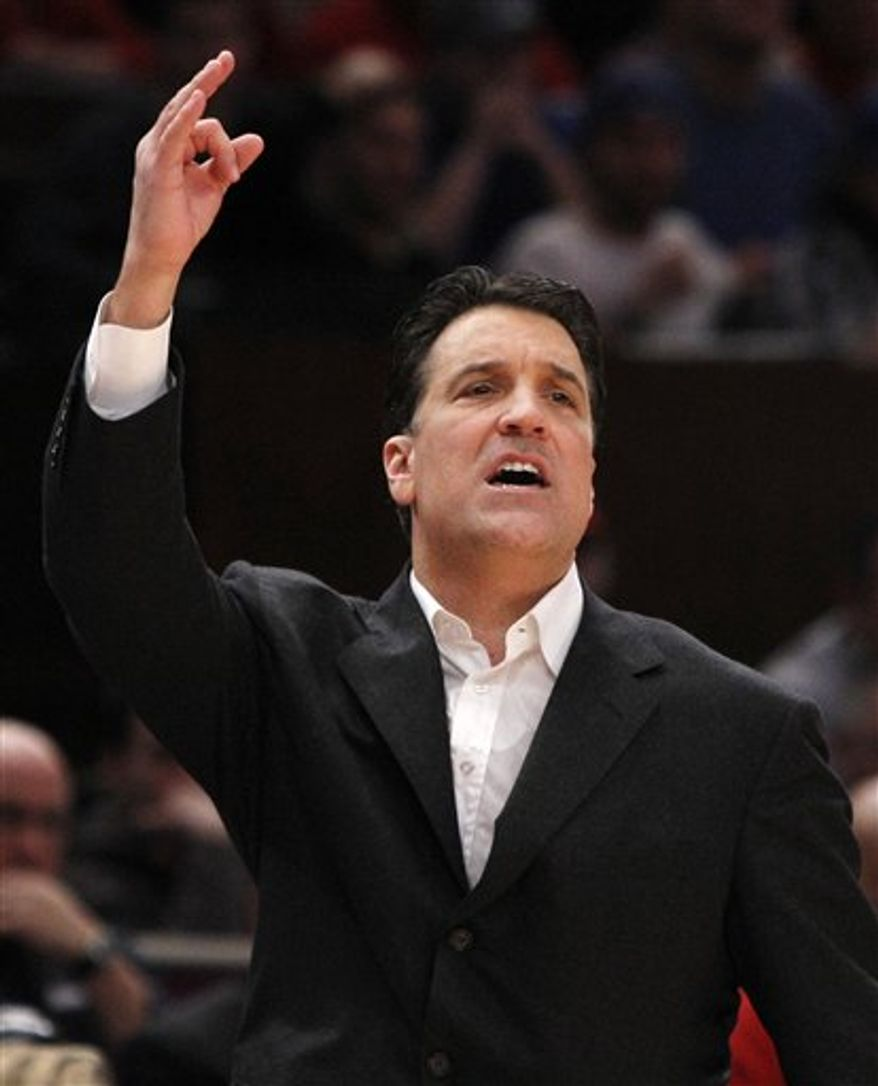 St. John's coach Steve Lavin gestures toward his team in the second half of their NCAA college basketball upset of Duke at Madison Square Garden in New York, Sunday, Jan. 30, 2011. St. John's defeated the third-ranked Blue Devils 93-78. (AP Photo/Kathy Willens)