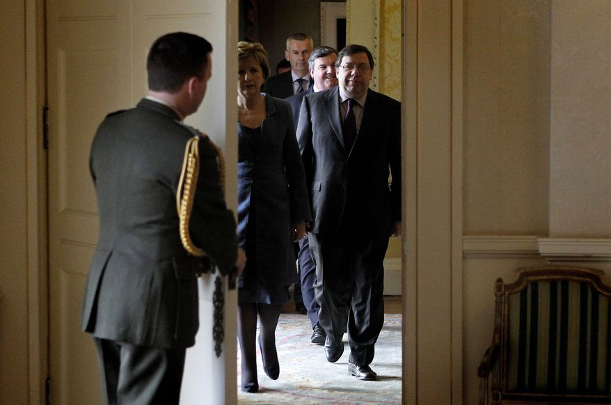 Irish Prime Minister Brian Cowen (right) and Irish President Mary McAleese (second from left) arrive at Aras an Uachtarain, the official residence of the Irish president, in Dublin on Tuesday, Feb. 1, 2011, to sign a request for a Proclamation of Dissolution of the Irish parliament. (AP Photo/Peter Morrison)