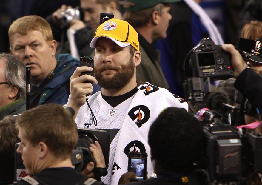 Pittsburgh Steelers' Ben Roethlisberger shoots video during media day for NFL football Super Bowl XLV, Tuesday, Feb. 1, 2011 in Arlington, Texas. (AP Photo/Mark Humphrey)