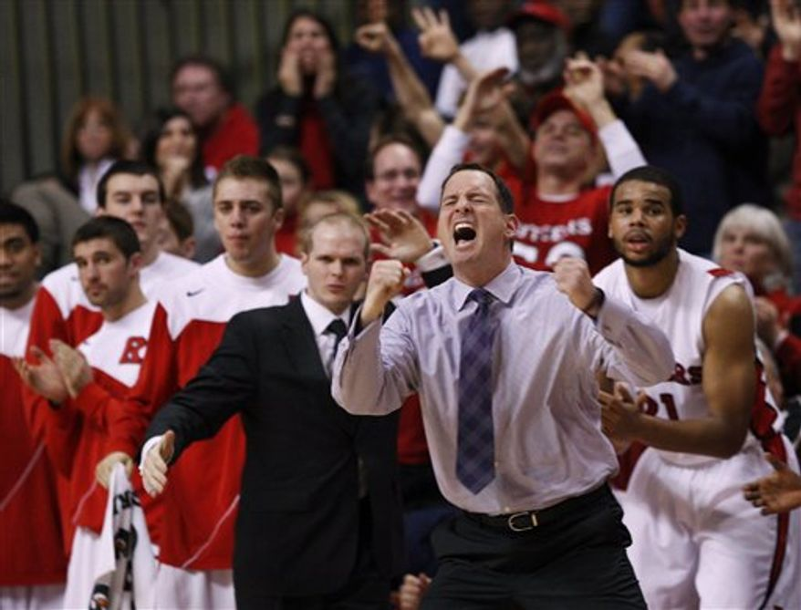 ** FILE ** Rutgers head coach Mike Rice, foreground, and others react to play late in the second half of an NCAA college basketball game against Pittsburgh, Saturday, Jan. 29, 2011, in Piscataway, N.J. Pittsburgh won 65-62. (AP Photo/Mel Evans)