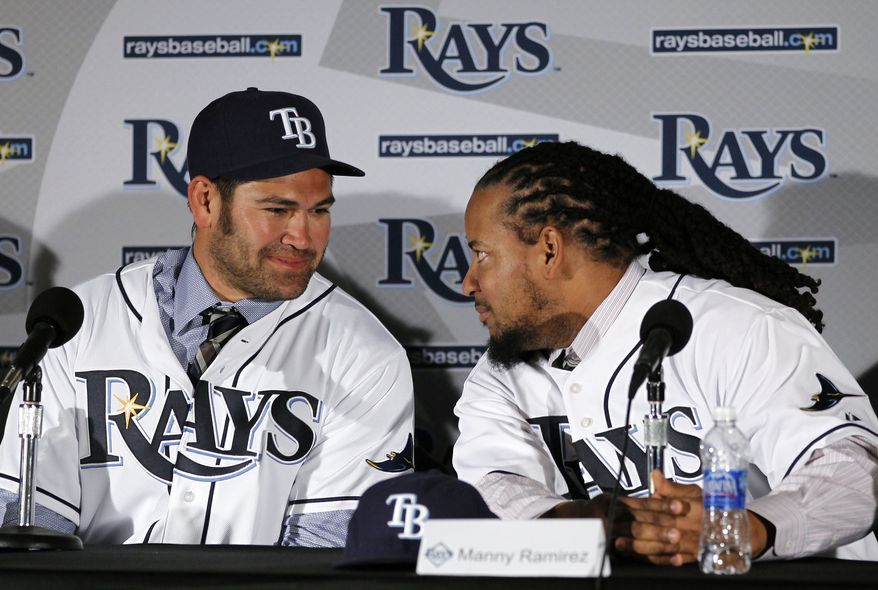 New Tampa Bay Rays baseball players Johnny Damon, left, and Manny Ramirez, right, chat after being introduced to the media during a news conference Feb. 1, 2011 in St. Petersburg, Fla. (AP Photo/Chris O'Meara)