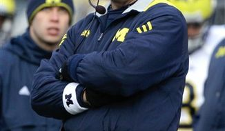 "FILE - In a Nov. 27, 2010, file photo, Michigan football coach Rich Rodriguez watches from the sideline as his team takes on Ohio State during an NCAA college football game in Columbus, Ohio. Rodriguez says the most frustrating part of being fired after three seasons as oach was that he thought the worst days were behind the program and the Wolverines were going to be ""exponentially"" better next season. (AP Photo/Amy Sancetta, File)"