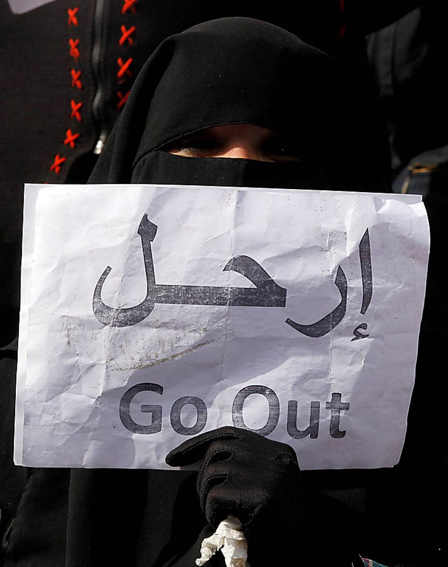 A veiled woman holds a poster calling for President Hosni Mubarak to step down, during demonstrations in Tahrir, or Liberation, Square in Cairo on Tuesday, Feb. 1, 2011. More than a quarter-million people flooded into the heart of Cairo, filling the city's main square in by far the largest demonstration in a week of unceasing demands for Mr. Mubarak to leave after nearly 30 years in power. (AP Photo/Victoria Hazou)