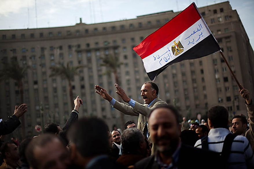 Anti-government protesters shout slogans as they arrive at Tahrir, or Liberation, Square in downtown Cairo on Tuesday, Feb. 1, 2011. Egyptian authorities battled to save President Hosni Mubarak's regime with a series of concessions and promises to protesters, but realities on the streets of Cairo may be outrunning his capacity for change. (AP Photo/Emilio Morenatti)
