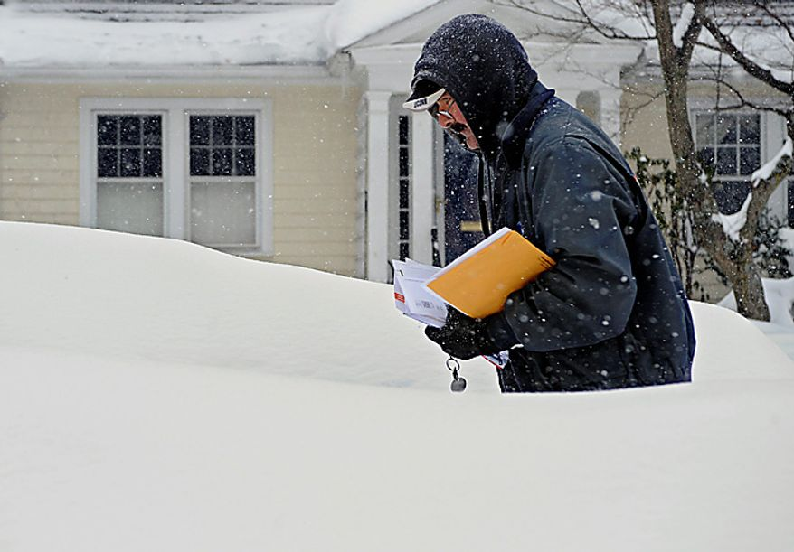Mail carrier Don Jacques makes his rounds during a winter storm in Hartford, Conn., on Tuesday, Feb. 1, 2011.  (AP Photo/Jessica Hill)
