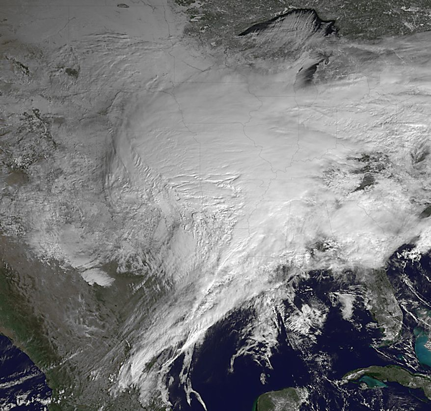 This satellite image provided by NOAA shows the winter storm covering the United States on Tuesday, Feb. 1, 2011. Layers of dangerous ice and blowing snow closed roads and airports from Texas to Rhode Island on Tuesday as the monster storm began bearing down on the nation and those in its frigid path started to believe it would live up to its hype. (AP Photo/NOAA)