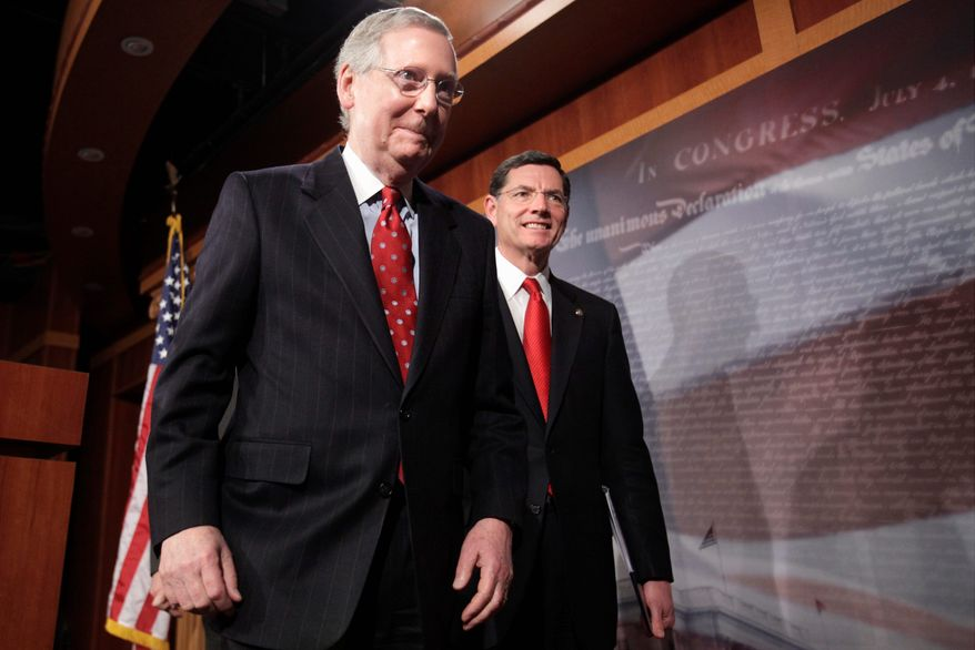 Sens. Mitch McConnell (left), Kentucky Republican, and John Barrasso, Wyoming Republican, depart after speaking to reporters about repealing the health care law at the Capitol on Wednesday. A party-line vote defeated the GOP-led repeal attempt. (Associated Press)