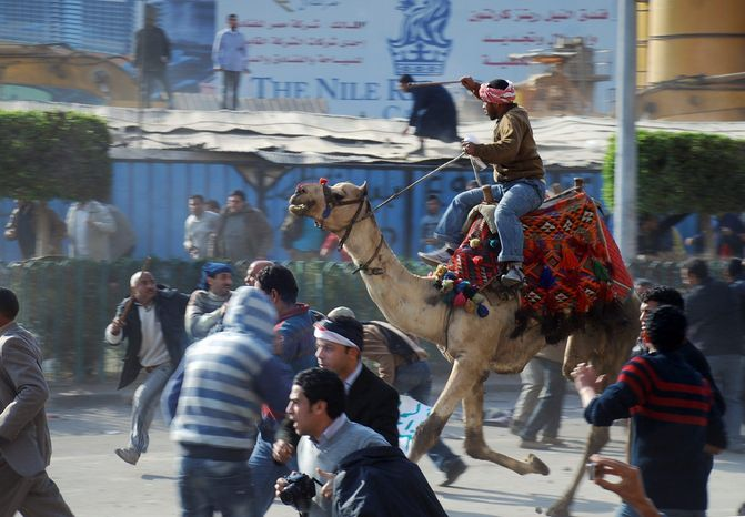 Riding a camel, a supporter of Egyptian President Hosni Mubarak fights with anti-Mubarak protesters in the streets of Cairo on Wednesday, Feb. 2, 2011, as Egypt's upheaval took a violent turn in its ninth day. (Associated Press)