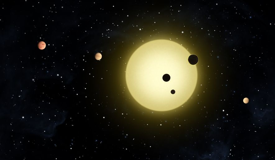 This artist rendering provided by NASA shows Kepler-11, a sun-like star around which six planets orbit. A planet-hunting telescope is finding whole new worlds of possibilities in the search for alien life, including more than 50 potential planets that initially appear to be in habitable zones. (Associated Press/NASA)