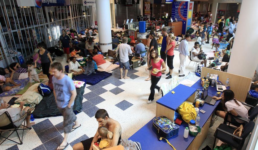 People pack a shopping mall used as a evacuation shelter in Cairns, Australia, Wednesday, Feb. 2, 2011, as a monster cyclone approaches the northeast coast with furious winds, rains and surging seas on a scale unseen in generations. Gusts up to 186 mph were expected when Cyclone Yasi strikes the coast late Wednesday after whipping across Australia's Great Barrier Reef. (AP Photo/Rick Rycroft)