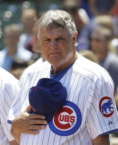 In this Thursday, June 17, 2010, file photo, Chicago Cubs manager Lou Piniella stands during the national anthem before an interleague baseball game against the Oakland Athletics at Wrigley Field in Chicago. The longtime skipper told The Associated Press on Wednesday, Feb. 2, 2011, he has agreed to a one-year contract with the San Francisco Giants to work as a special assistant for the World Series champions. Sweet Lou will report to general manager Brian Sabean. (AP Photo/Charles Rex Arbogast)