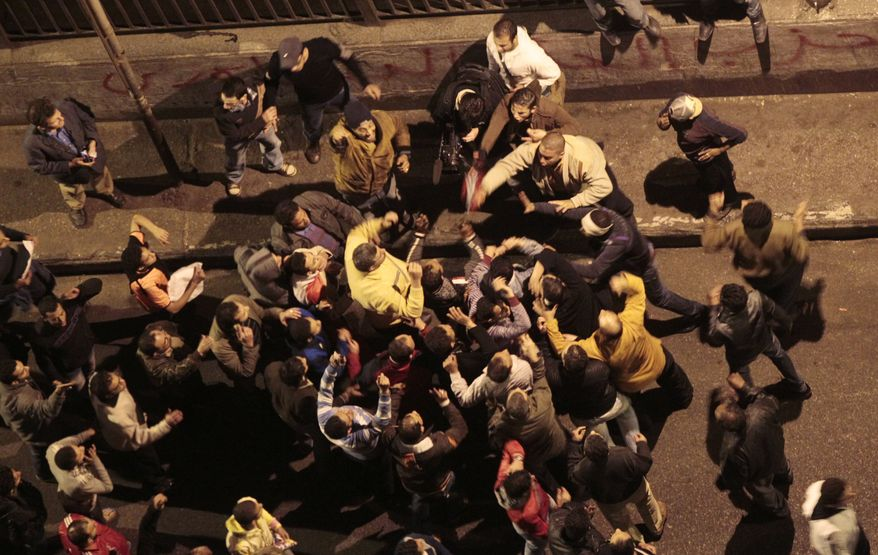 Supporters of Egyptian President Hosni Mubarak scuffle with anti-government protesters near Tahrir, or  Liberation, Square in central Cairo on Wednesday, Feb. 2, 2011. (AP Photo/Lefteris Pitarakis)