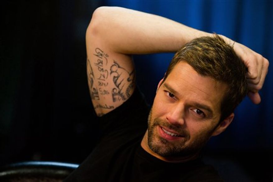 In this Jan. 31, 2011 photo, singer Ricky Martin poses for a portrait in New York. (AP Photo/Charles Sykes)