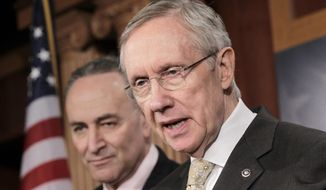 ** FILE ** Senate Majority Leader Harry Reid of Nevada, accompanied by Sen. Charles Schumer, D-N.Y., speaks during a news conference on Capitol Hill in Washington on Tuesday, Feb. 2, 2011. (AP Photo/J. Scott Applewhite)