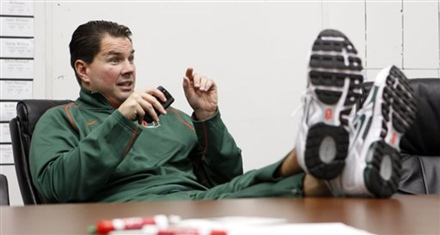 Miami head coach Al Golden gestures as he talks to coaches in the meeting room during signing day in Coral Gables, Fla., Wednesday, Feb. 2, 2011. (AP Photo/Alan Diaz)