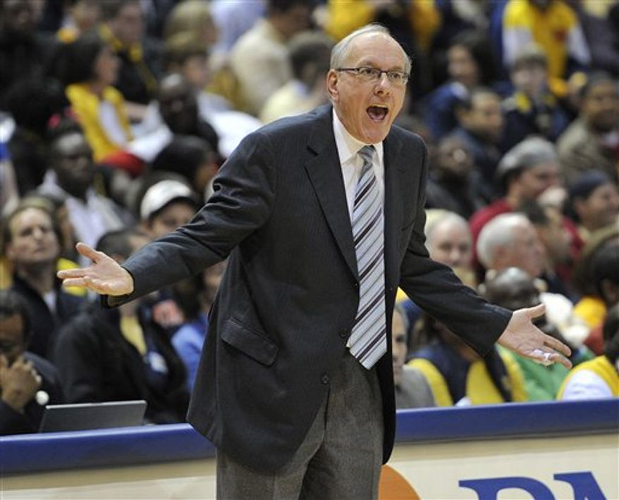 Syracuse head coach Jim Boeheim yells out to his team as they play Marquette during the first half of an NCAA college basketball game Saturday, Jan. 29, 2011, in Milwaukee. (AP Photo/Jim Prisching)