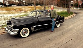 Randy Denchfield stands proudly by his 1949 Cadillac sedan, which has less than 40,000 miles.