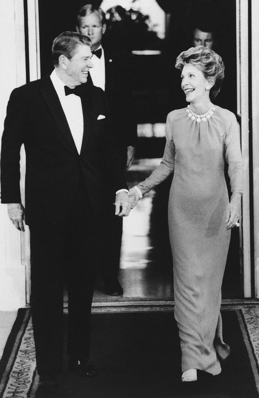 First lady Nancy Reagan gives a loving look toward President Reagan as they walk outside the White House on July 16, 1986. The Reagans were waiting to greet their state dinner guest, Pakistani Prime Minister Mohammad Khan Junejo. (Associated Press)