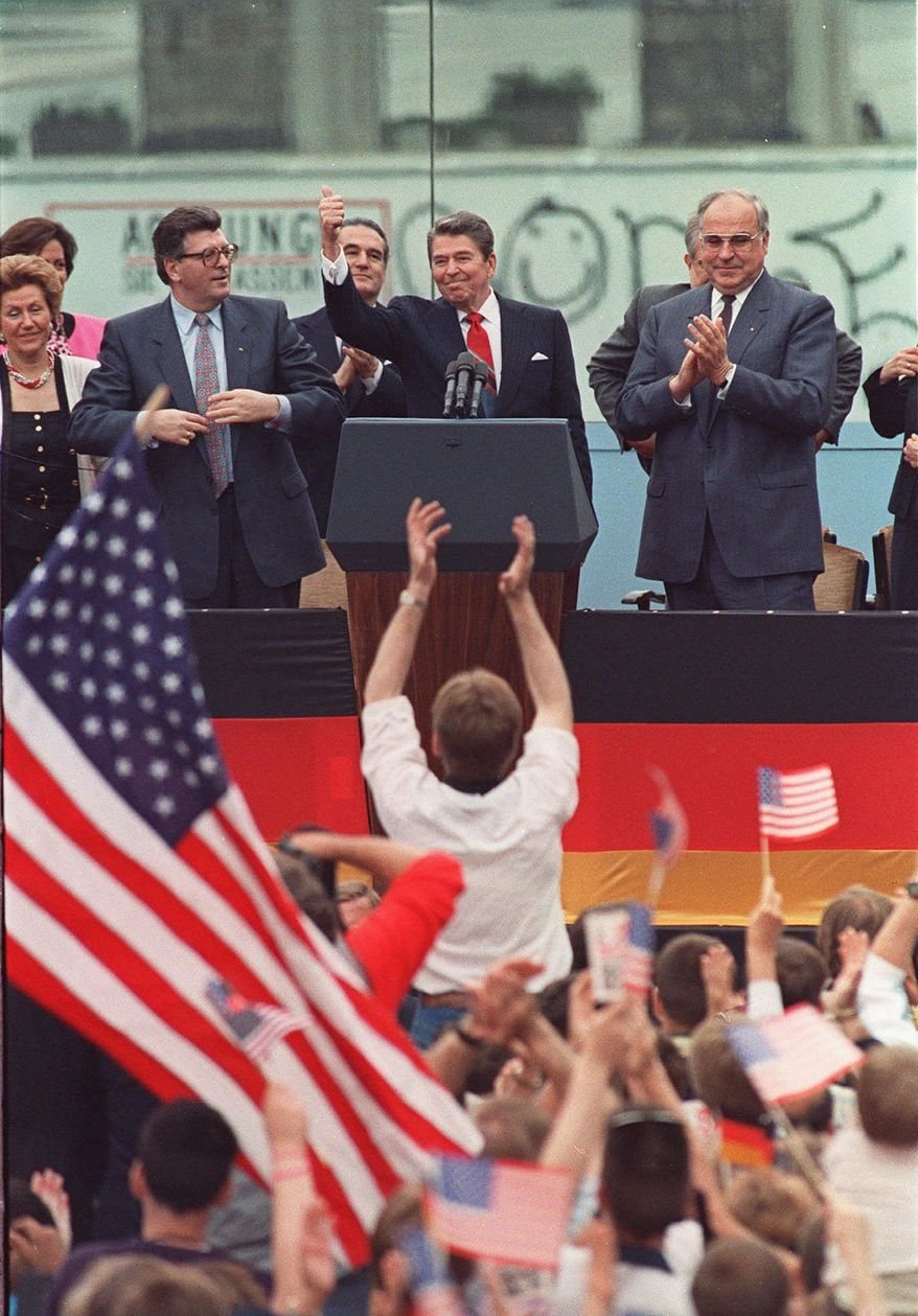 """President Reagan is flanked by West German Parliament President Philipp Jenninger (left) and Chancellor Helmut Kohl at West Berlin's Brandenburg Gate, where he said, """"Mr. Gorbachev, tear down this wall!"""" (Associated Press)"""