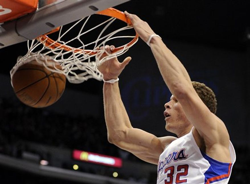 Los Angeles Clippers power forward Blake Griffin dunks the ball during the first half of their NBA basketball game against the Charlotte Bobcats, Saturday, Jan. 29, 2011, in Los Angeles.  (AP Photo/Mark J. Terrill)
