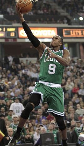 Boston Celtics guard Ray Allen shoots over Sacramento Kings guard Beno Udrih, left, of Slovenia, during the first quarter of an NBA basketball game in Sacramento, Calif., Tuesday, Feb. 1, 2011. (AP Photo/Rich Pedroncelli)