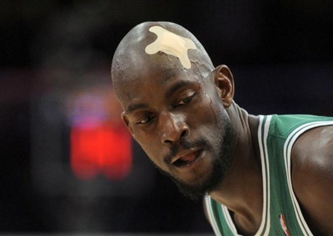 Boston Celtics power forward Kevin Garnett wears a bandage after getting cut during the first half of an NBA basketball game against the Los Angeles Lakers in Los Angeles, Sunday, Jan. 30, 2011. (AP Photo/Chris Carlson)