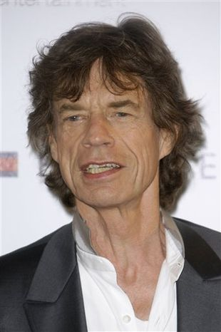 """FILE - In this May 19, 2010 file photo, musician Mick Jagger poses during a photo call for the film """"Stones in Exile"""", at the 63rd international film festival, in Cannes, southern France. (AP Photo/Joel Ryan, file)"""
