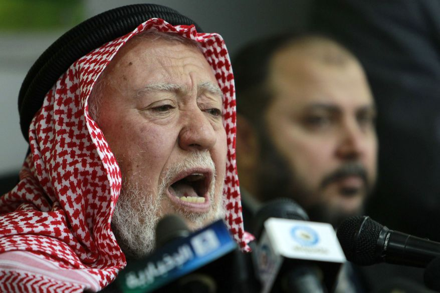 Islamic Action Front leader Hamza Mansour speaks during a press conference in Amman, Jordan, Tuesday, Jan.18, 2011. Mr. Mansour on Thursday, Feb. 3, 2011, rejected an offer from Jordan's new prime minister to join his reform Cabinet. (AP Photo/Nader Daoud)