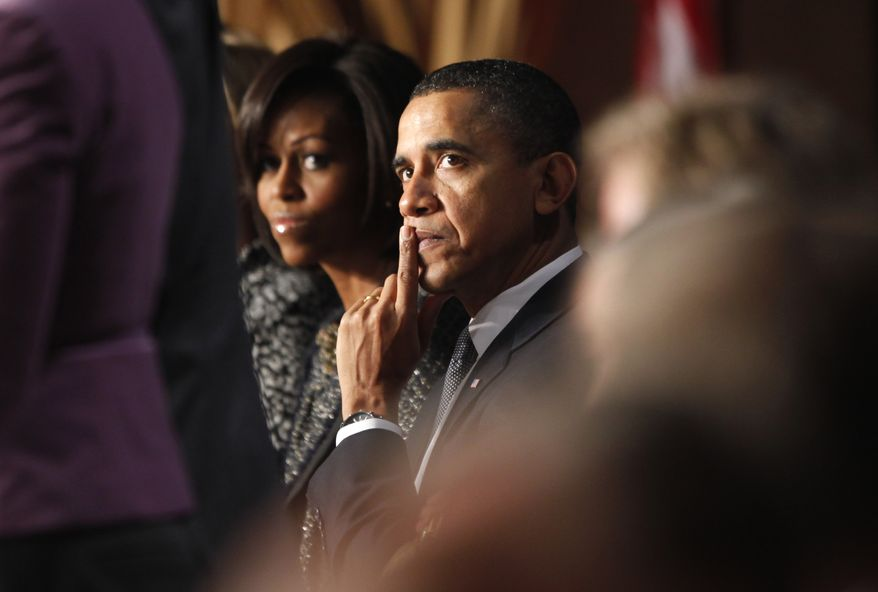 President Obama and first lady Michelle Obama attend the National Prayer Breakfast in Washington, Thursday, Feb. 3, 2011. (AP Photo/Charles Dharapak)
